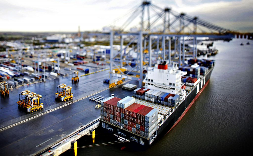 First Container Ship Docks To Unload Cargo At New London Gateway Port...The MOL Caledon container ship, operated by Mitsui O.S.K. Lines Ltd., sits moored to the dock side in this photograph taken with a tilt-shift lens at DP World Ltd.'s newly operational London Gateway deep-sea container terminal port in Stanford-Le-Hope, U.K., on Thursday, Nov. 7, 2013. DP World's London Gateway port received its first ship today following a decade-long project to build a deep-water haven close to the U.K. capital that aims to become one of Europe's busiest container terminals. Photographer: Matthew Lloyd/Bloomberg